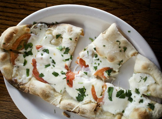 The caprese flatbread at Three Kings serves stone-baked flatbread topped with fresh tomatoes, mozzarella and basil. - JENNIFER SILVERBERG