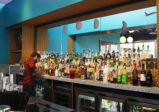 The well-stocked bar at the New Moon Room | Kaitlin Steinberg