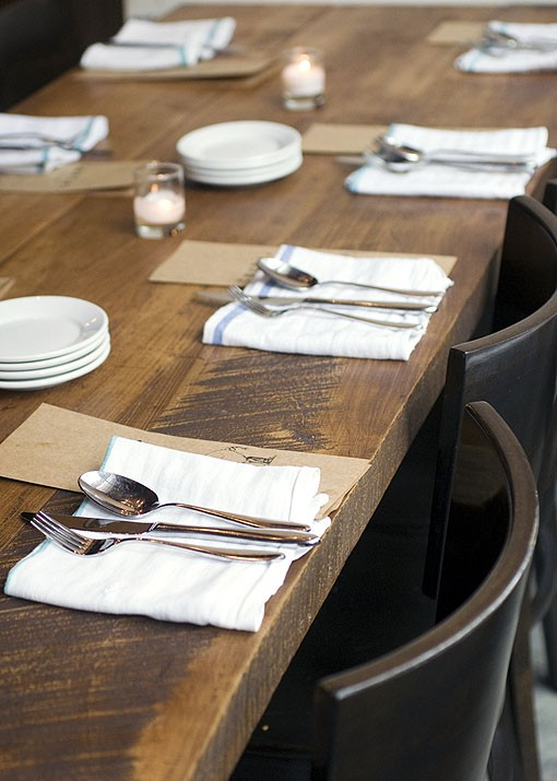 Simply-set tables greet diners when they arrive in the Benton Park restaurant. See a slideshow of photos from Taste by Niche. - PHOTO: JENNIFER SILVERBERG