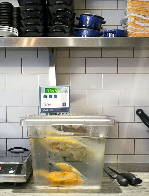The immersion circulator got its start in science labs, but was later brought into the kitchen as a way to evenly cook and maintain exact temperatures by placing vacuum-sealed food in a water bath at an exact and desired temperature. This process is called sous vide, which means, under vacuum. In addition to its precision, chef Gerard Craft also likes it for its space-saving dimensions.  See a slideshow of photos from Taste by Niche. - PHOTO: JENNIFER SILVERBERG