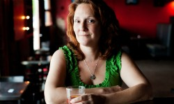 Culinary historian Elizabeth Pearce sips a Sazerac cocktail. - IMAGE VIA