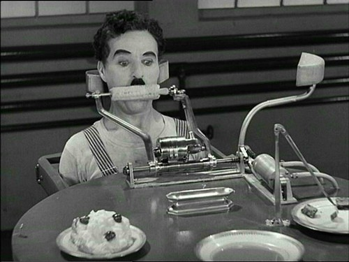 Chaplin versus the Bellows Feeding Machine. - IMAGE SOURCE