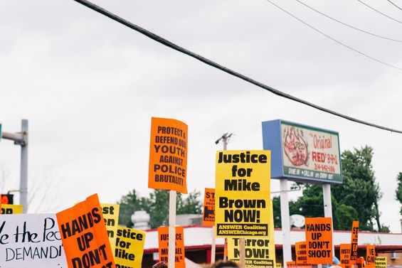 A protest happening outside of Red's on August 30, 2014. | Bryan Sutter