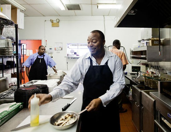 DeMarco Howard in the Gobble Stop kitchen - JENNIFER SILVERBERG
