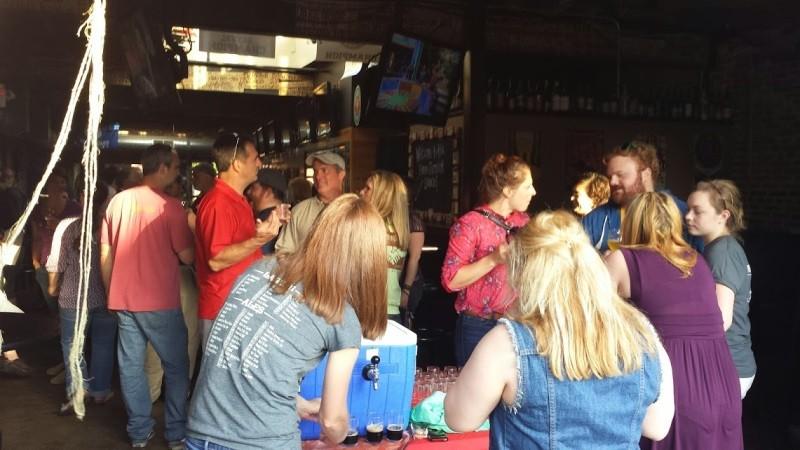 The crowd enjoys homebrew samples - RICHARD HAEGELE
