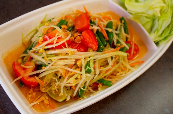 Papaya salad with tomatoes, green beans, carrots and peanuts. - MABEL SUEN
