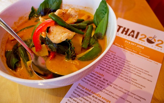 Red curry with chicken, coconut milk, bamboo shoots, green beans, bell pepper and basil, served with steamed rice. - MABEL SUEN