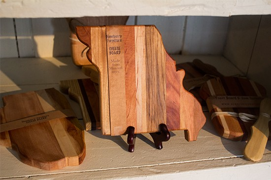 Cutting boards and other kitchen implements are scattered throughout the store.