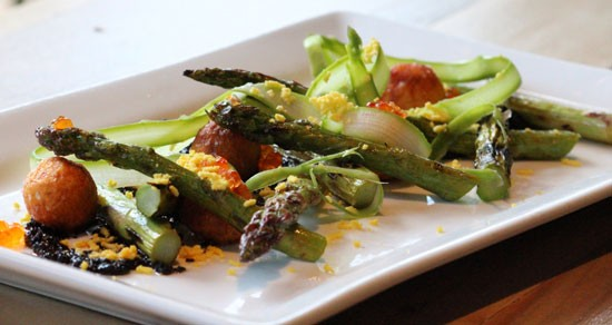 Illinois asparagus with black garlic romesco, Midwest caviar, fried potato balls and boiled farm egg. | Evan C. Jones