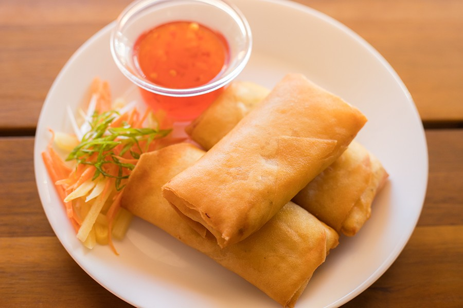 Crab rangoons are served with sweet chile sauce. - MABEL SUEN