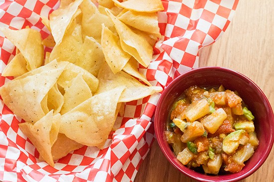 Pineapple and avocado salsa with chips.