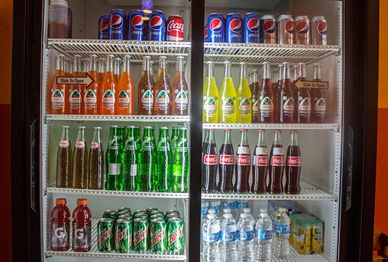 Beverage options include Mexican sodas and more.