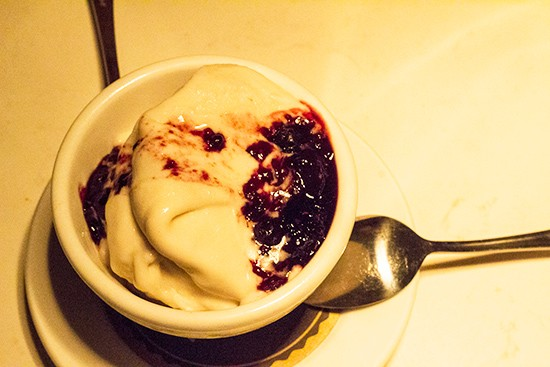 Vegan ice cream with warm berry compote for dessert.
