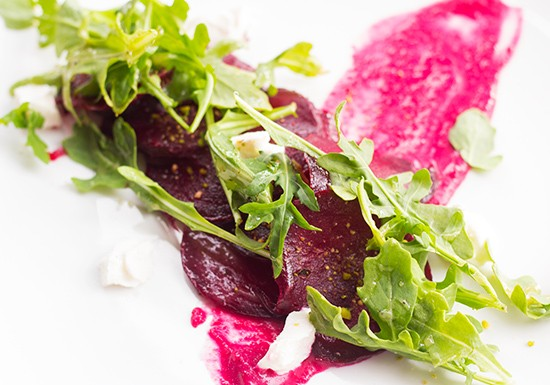 Roasted heirloom beet salad with goat cheese, beet meringue, toasted pisachio and honey-thyme vinaigrette.