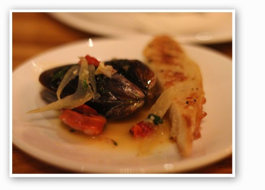 Steamed Prince Edward Island mussels with cider, chorizo, half-dried tomatoes and fennel. | Nancy Stiles