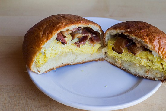 Baked bun with egg and bacon.