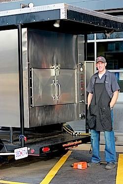 "Co-owner Matt Stiffelman and his ""showy"" smoker. - KAITLIN STEINBERG"