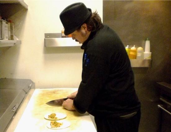 Brandt's Cafe chef Matt Dawson prepares duck tacos. - DEBORAH HYLAND