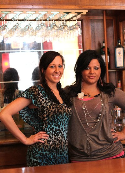 Waitress Candi Williams and bartender Terri Schuerman behind the bar at Fox Park Grille. - MABEL SUEN