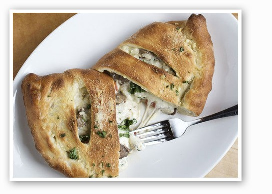 Also available: the veggie calzone with herb ricotta, wild mushrooms, spinach, roasted red peppers, caramelized onions, mozzerella and parmesan. | Jennifer Silverberg