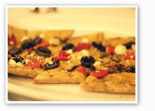 Za'atar flatbread, with carrot harissa hummus, grilled vegetables, kalamata olives and Goatsbeard Farm feta. | Nancy Stiles
