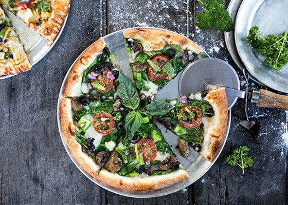 "The ""Chestnut Street"" pie is topped with olive oil, roasted garlic and mozzarella, as well as a host of vegetables, including onions, peppers, olives, tomatoes and mushrooms. 