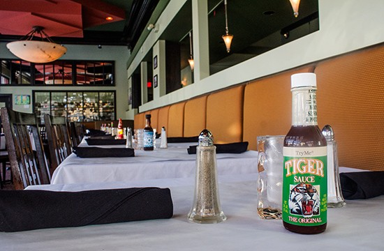 A different kind of hot sauce for every table.