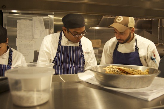 Executive chef Wilfrin Fernandez (right) instructs a team member in the kitchen. - LIZ MILLER
