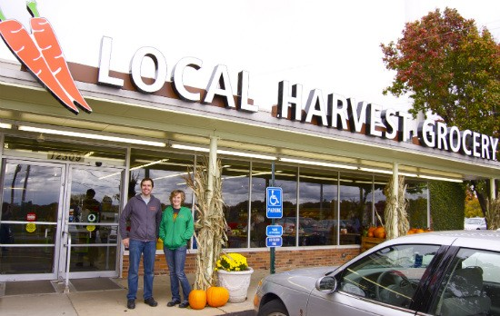 Local Harvest Grocery co-owners Patrick Horine and Maddie Earnest in front of their new location in Kirkwood. - LIZ MILLER