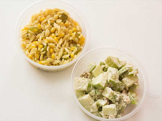Roasted corn and pepper orzo salad; waldorf salad with apple, celery, walnuts, mayonnaise.