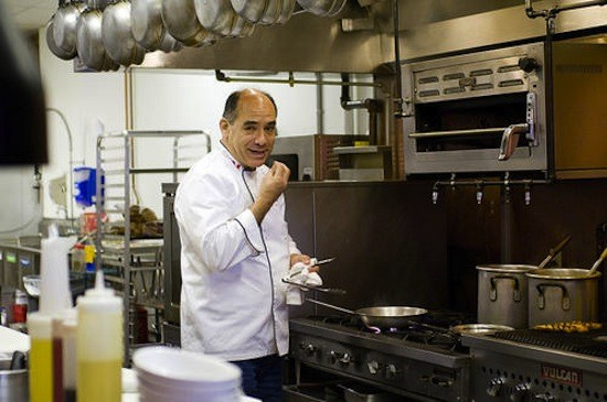 Mango Peruvian Cuisine owner Jorge Calvo in the restaurant's kitchen - JENNIFER SILVERBERG