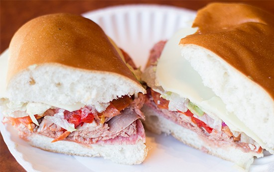 "The ""Racanelli's Special"" sandwich with roast beef, Genoa salami, provolone, lettuce, tomato, oil and vinegar, dressing and fire-roasted sweet red peppers."