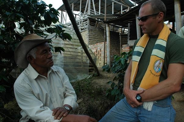 2008 Lo Mejor de Monserrate cupping winner, Mesael Iquinas, and Atlas Coffee Importer president, Craig Holt, discuss this years increased rain fall, which leads to increased presence of Coffee Leaf Rust, a plant disease that leads to a smaller harvest - COURTESY MIKE MARQUARD
