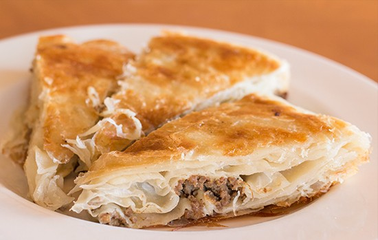 Burek with ground-beef stuffing. Additional savory pastry options come filled with cheese and/or spinach.