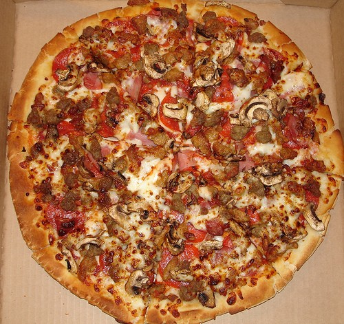 A Meat Lover's pizza from Pizza Hut. If you're going to eat and tweet on your phone, make sure own one of these (below). - IMAGE SOURCE
