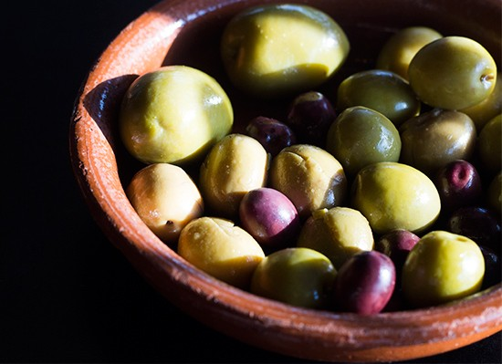 A bowl of assorted Spanish olives.