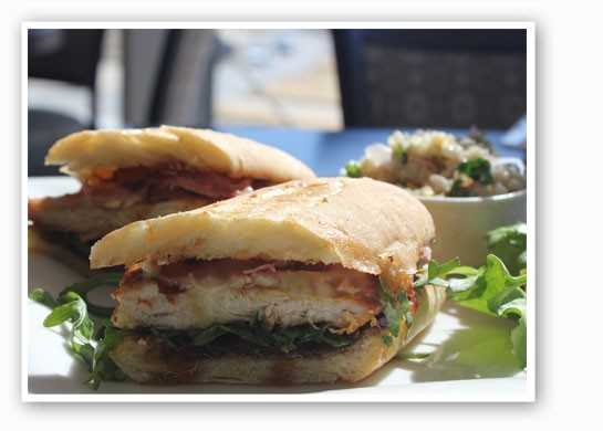Proscuitto and grilled chicken sandwich with brie, arugula, caramelized apple and onion        marmalade. | Nancy Stiles