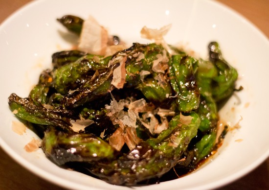 Wood grilled shishito peppers with sweet soy and bonito flakes. - MABEL SUEN