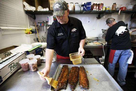 Pitmaster Skip Steele glazes ribs at Bogart's Smokehouse. - JENNIFER SILVERBERG