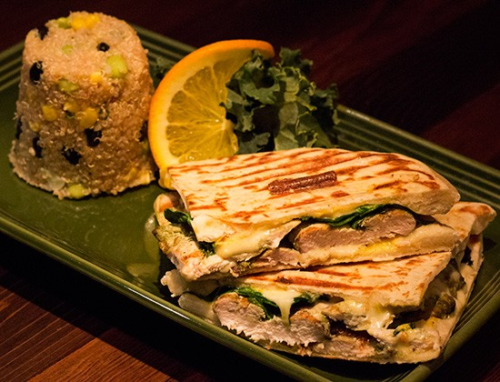 """""""Bombay Panini"""" with grilled chicken, cilantro, pepper-jack cheese, baby spinach and spicy curry sauce on naan, with a side of quinoa. - PHOTOS BY MABEL SUEN"""