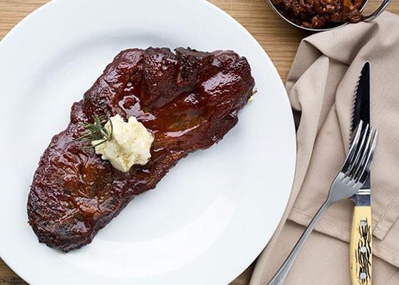 The bone-in pork steak at Gamlin Whiskey House. | Jennifer Silverberg