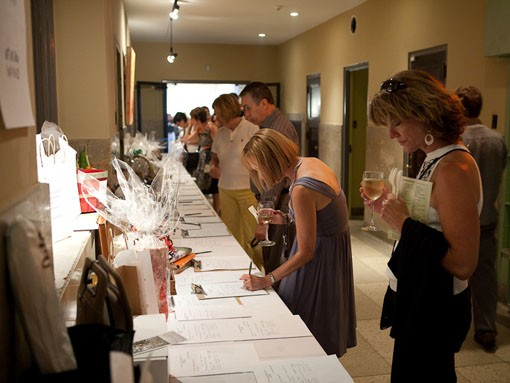 More bidding on gift baskets at the Art of Food. - PHOTO: STEW SMITH
