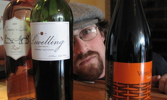 Here's looking at you! Jeff Stettner, proprietor of 33 Wine Shop & Tasting Bar in Lafayette Square. - DAVE NELSON