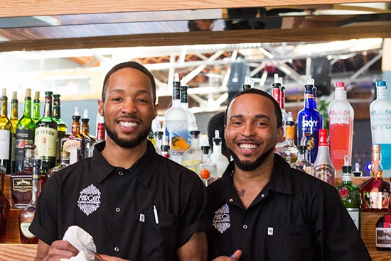 Staff behind the bar.