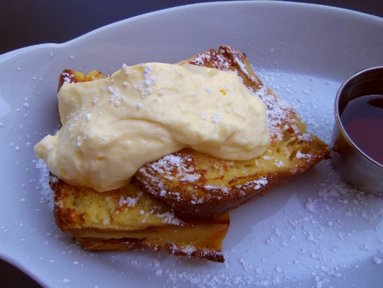 The brioche French toast with lemon curd at Brasserie by Niche. - EMILY WASSERMAN