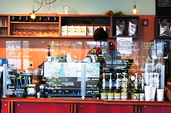 Pick your caffeinated poison at the counter at Chronicle Coffee. - CAILLIN MURRAY