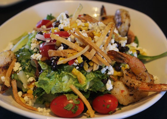 Cilantro lime shrimp salad, with roasted corn, black beans, feta, grape tomatoes, red onion, tortilla strips and cilantro lime vinaigrette. | Nancy Stiles