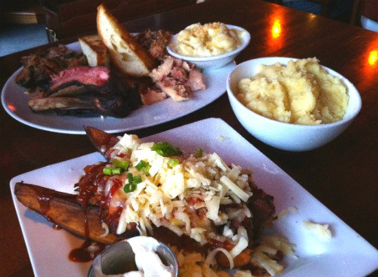 "Loaded smoked potato wedges, the ""Big Jimmy"" sampler and caramelized onion mashed potatoes at the Shaved Duck. - LIZ MILLER"