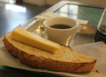 Toasted French peasant bread with Havarti cheese and Cesmach coffee. - NANCY STILES