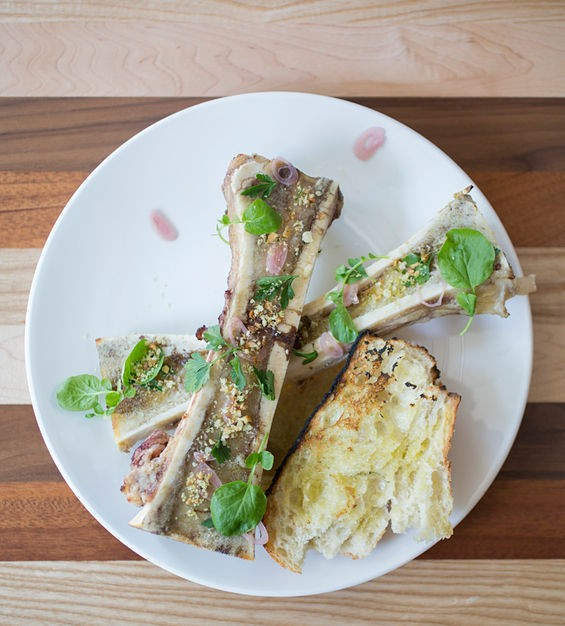 Decadent bone marrow with grilled bread, watercress and shallots. - JENNIFER SILVERBERG